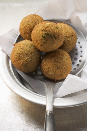slotted: Falafel (chick-pea balls) on slotted spoon