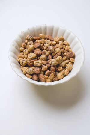 mixed nuts: Mixed nuts to nibble in white bowl LANG_EVOIMAGES