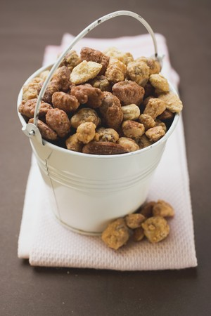 mixed nuts: Mixed nuts to nibble in white bucket LANG_EVOIMAGES