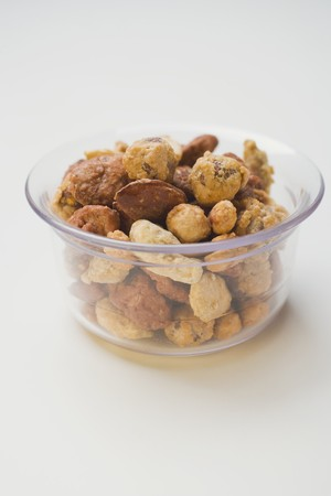 mixed nuts: Mixed nuts to nibble in glass bowl