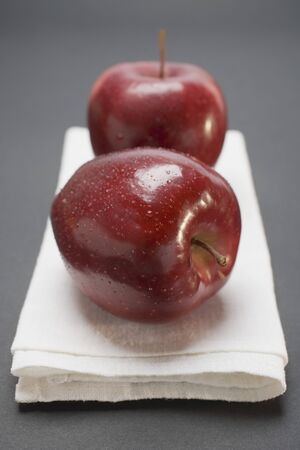 stark: Two red apples, variety Stark, on linen cloth