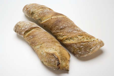 several breads: Two rustic baguettes