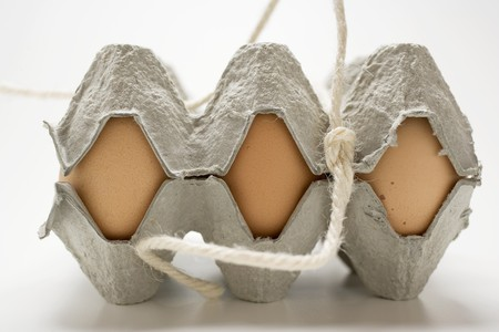 green egg box brown eggs with feathers in an egg box stock photo picture and