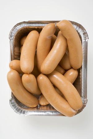 scalded sausage: Fresh frankfurters in aluminium container