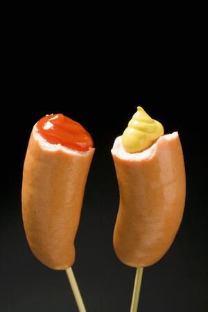 wienie: Two half frankfurters with mustard and ketchup