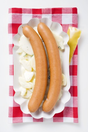 wienie: Frankfurters with potato salad in paper dish, mustard LANG_EVOIMAGES