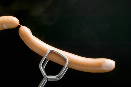 scalded sausage: Tongs holding frankfurters LANG_EVOIMAGES
