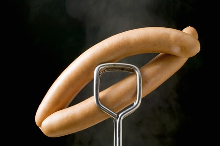 space for type: Tongs holding frankfurters LANG_EVOIMAGES