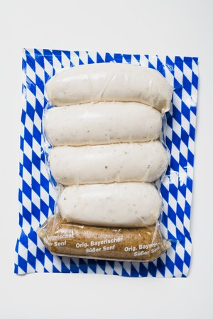 scalded sausage: Weisswurst (white sausages) in packaging with mustard