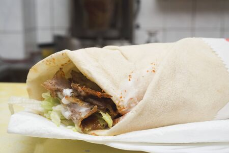 ner: D�ner wrap on paper napkin in snack bar