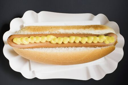 wienie: Hot dog with mustard in paper dish