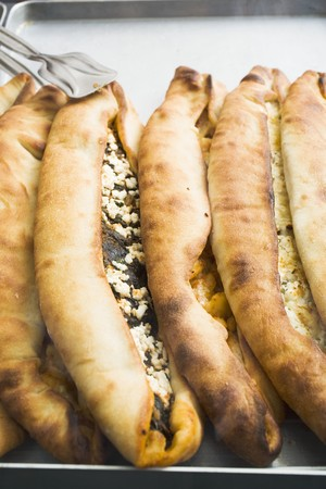 southern european: Pide (Turkish flatbread) with sheeps cheese filling LANG_EVOIMAGES