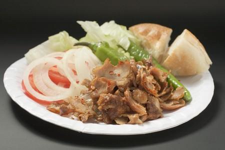 kebob: Döner meat with vegetables and flatbread on paper plate