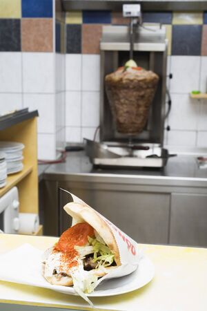 ner: D�ner kebab on a snack bar counter