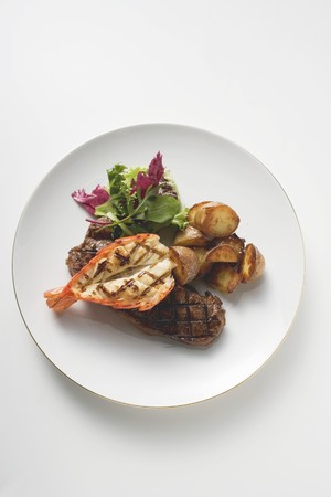 barbecues: Surf and Turf (beef steak and prawn) with fried potatoes