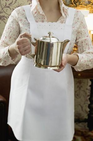 coffeepots: Chambermaid holding silver pot