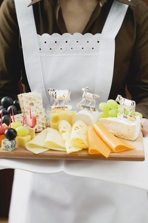 cheeseboard: Waitress serving a cheese platter