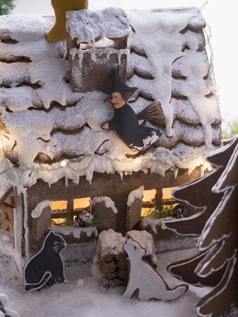 figurative: Gingerbread house with gingerbread animals and witch