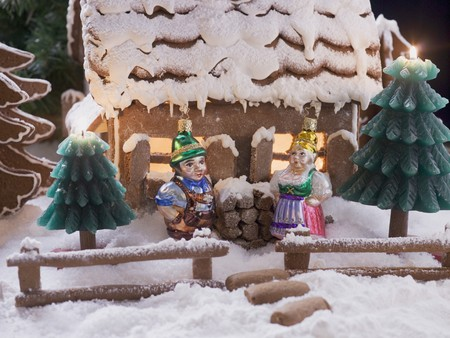 figurative: Gingerbread house with Christmas tree ornaments