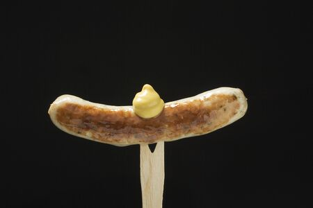 barbecues: Sausage with mustard on wooden fork