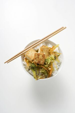 beancurd: Tofu with stir-fried vegetables on rice (overhead view)