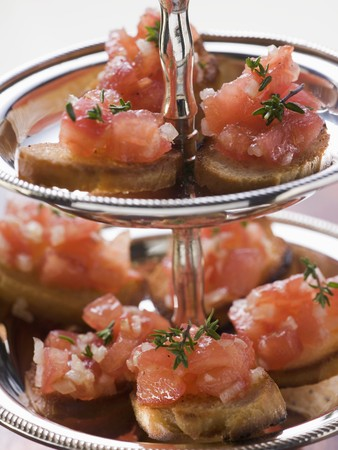 several breads: Bruschetta on tiered stand