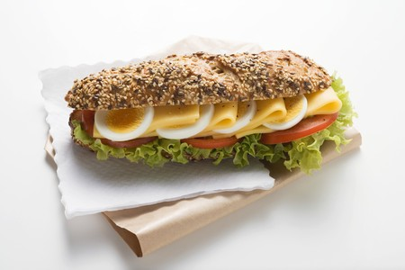 hero sandwich: Granary roll filled with egg, cheese, tomato and lettuce