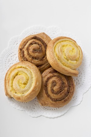 doiley: Four coiled buns on doily