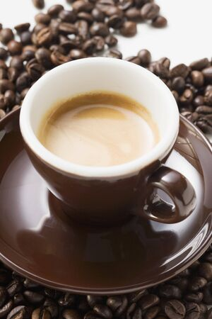 brownness: Cup of espresso on coffee beans LANG_EVOIMAGES