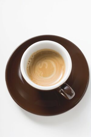 crema: Cup of espresso with cream (overhead view)