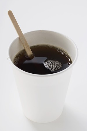 stirrer: Black coffee in paper cup with wooden stirrer LANG_EVOIMAGES