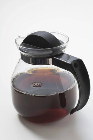 coffeepots: Black coffee in glass jug