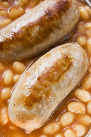 baked beans: Baked beans with sausages (close-up)
