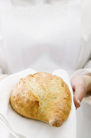 serve one person: Chambermaid serving bread on fabric napkin