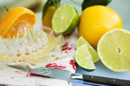 'main squeeze': Assorted citrus fruit with citrus squeezer