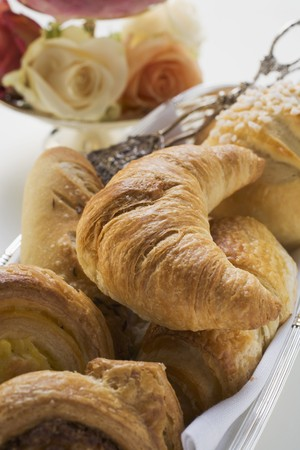 pastes: Bread rolls and sweet pastries in bread basket