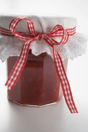 Jar of strawberry and rhubarb jam LANG_EVOIMAGES