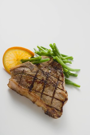 vulgar: Grilled T-bone steak with French beans