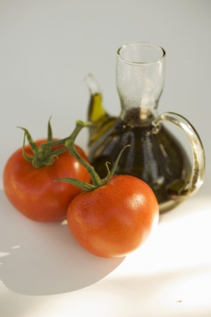 carafe: Fresh tomatoes and carafe of oil LANG_EVOIMAGES