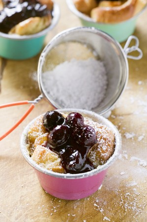 several breads: Individual bread puddings with cherries & icing sugar