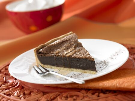 chocolate tart: A piece of chocolate tart