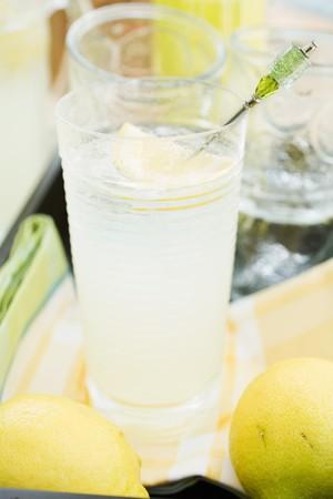 soda pops: A glass of lemonade and lemons