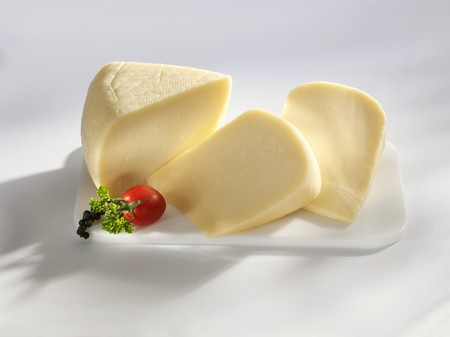 rumanian: Three pieces of Kashkaval (sheeps milk cheese, Romania)