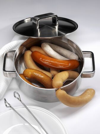 scalded sausage: Various types of sausages in a pan LANG_EVOIMAGES