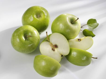 pip: Four Granny Smith apples, one cut into pieces