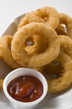 collation: Squid rings in paper dish with dip