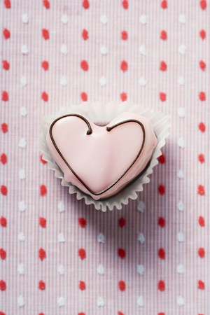 a frill: Heart-shaped sweet with pink icing
