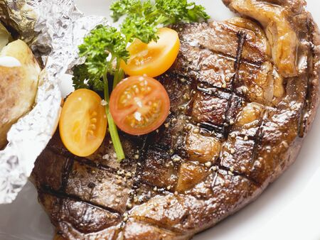 rumpsteak: Grilled rump steak with tomatoes and baked potato