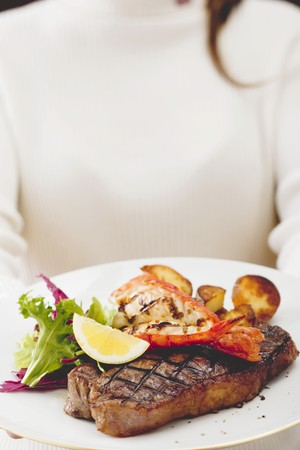 sirloin steak: Grilled sirloin steak with lobster and roast potatoes
