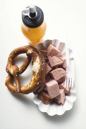 collation: Warm Leberkäse (type of meatloaf), in pieces, with pretzel